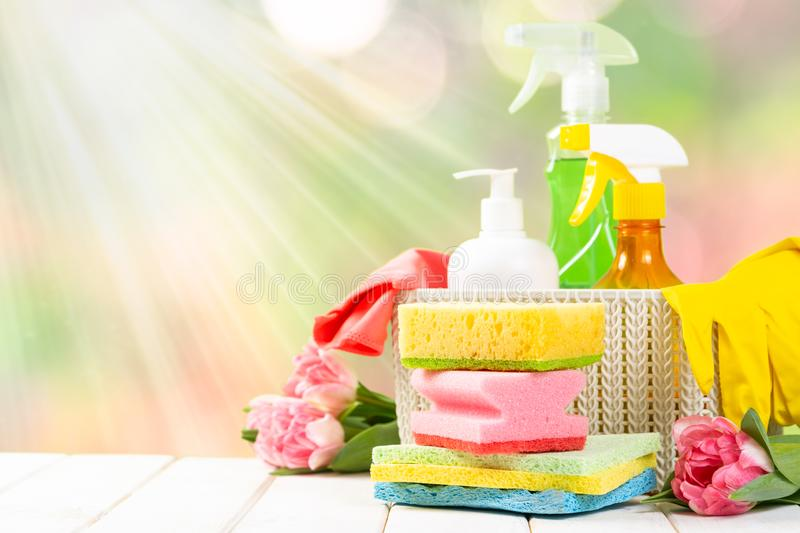 Spring cleaning concept - cleaning products, gloves. Bokeh background, copy space stock image