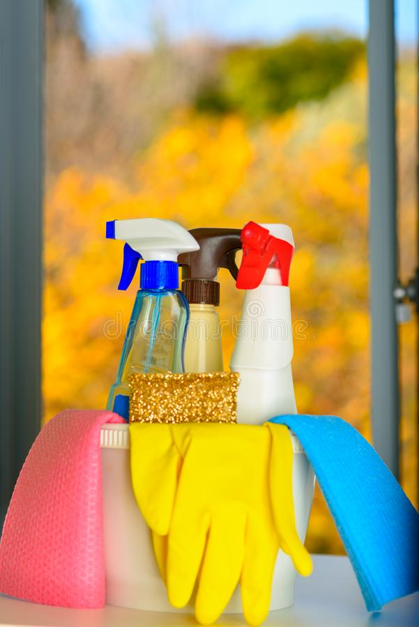 Spring cleaning concept with supplies over floral background. stock images