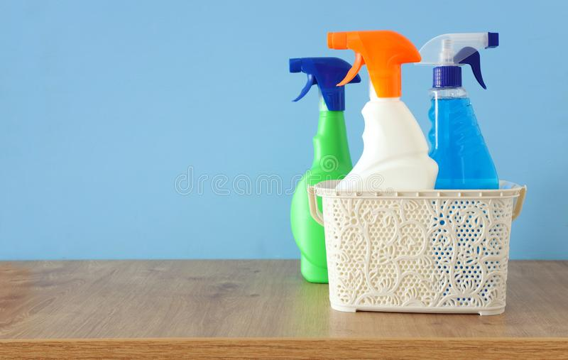 Spring cleaning concept with supplies on wooden table. Spring cleaning concept with supplies over blue wooden background stock images