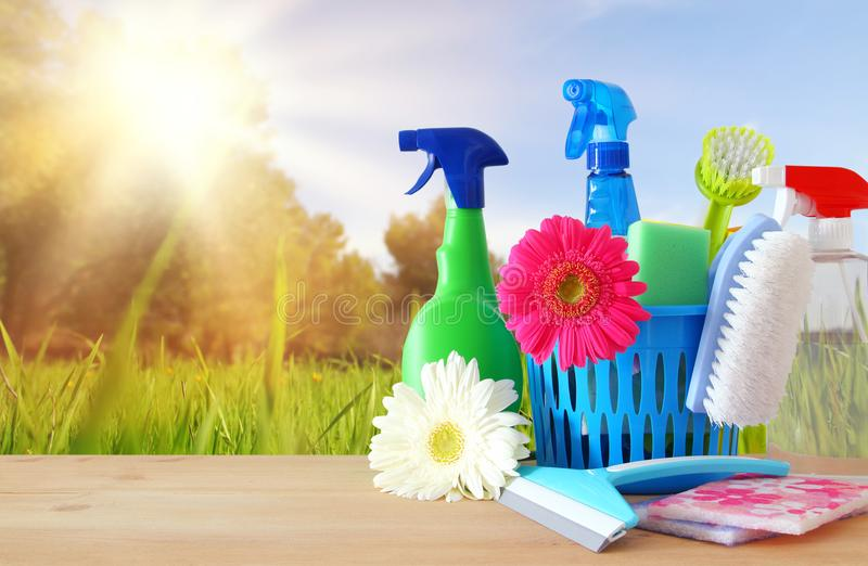 Spring cleaning concept with supplies on wooden table. Spring cleaning concept with supplies on wooden table stock photos