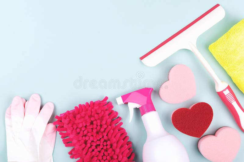 Spring cleaning products on light green background stock photos