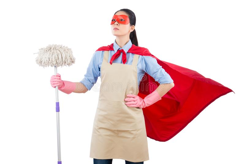 Spring cleaning superhero housewife. Successful confidence mixed race spring cleaning superhero housewife cleaning floor with mop. isolated on white background stock photography