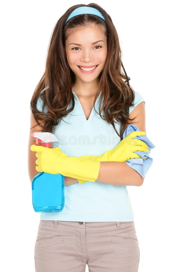 Spring cleaning woman. Ready for spring cleaning smiling with rubber gloves and cleaning products. Pretty smiling young mixed race Asian / Caucasian girl royalty free stock image