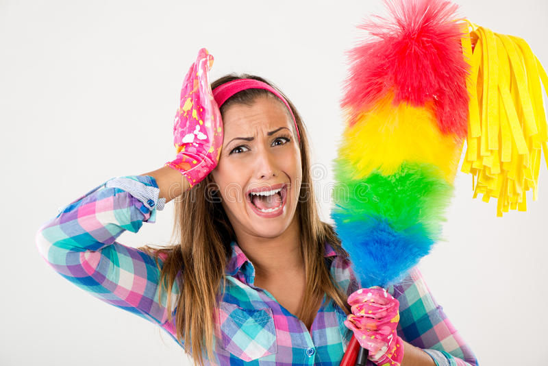 Spring Cleaning Woman. Screaming. She is stressed and looking at camera. White background royalty free stock photo