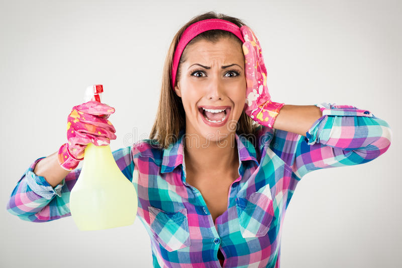 Spring Cleaning Woman. Screaming. She is stressed, wearing pink rubber gloves and looking at camera. White background stock photo