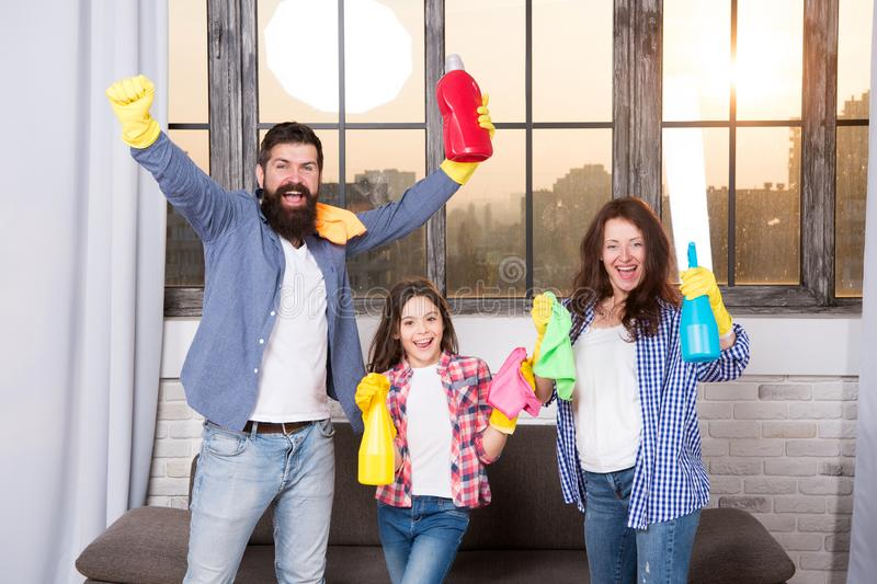 Spring cleaning. Your one stop for home cleaning needs. Happy family hold cleaning products. Mother, father and daughter stock images