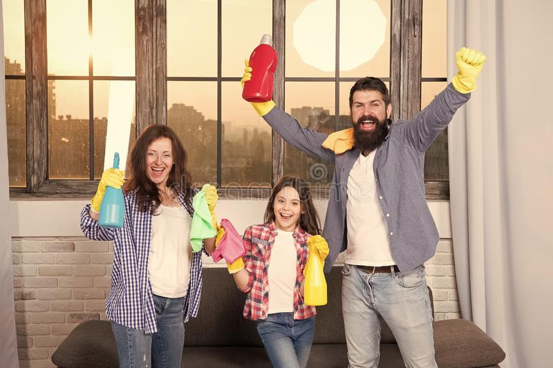 Spring cleaning. Your one stop for home cleaning needs. Happy family hold cleaning products. Mother, father and daughter. Clean house in spring. Ready for royalty free stock images