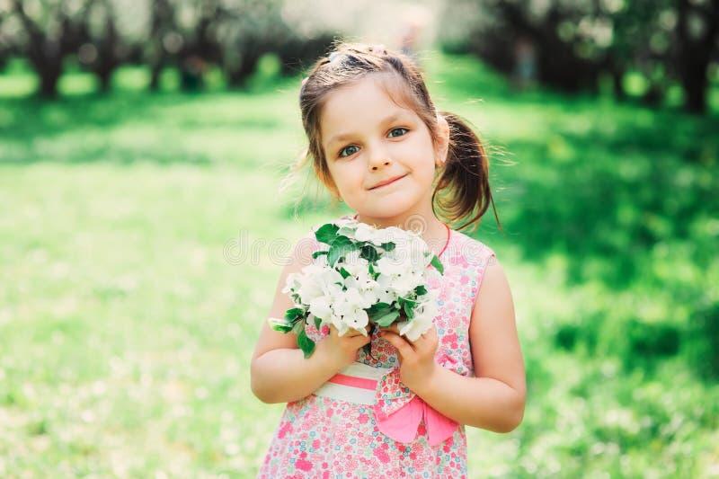 Spring closeup outdoor portrait of adorable kid girl royalty free stock photos