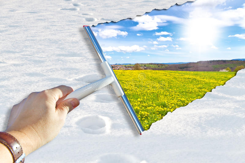 Spring is coming. Abstract photo of a man with wiper - in foreground snow in background a flower meadow in spring royalty free stock photo