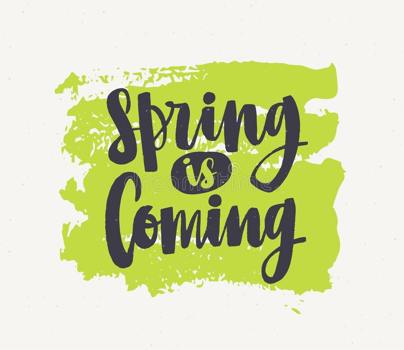 Spring Is Coming lettering written with elegant cursive font or script on green paint smear isolated on white background. Handwritten springtime inspirational royalty free illustration