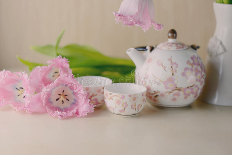 Spring composition. Festive still life on a light background pink tulips and tea service royalty free stock photo