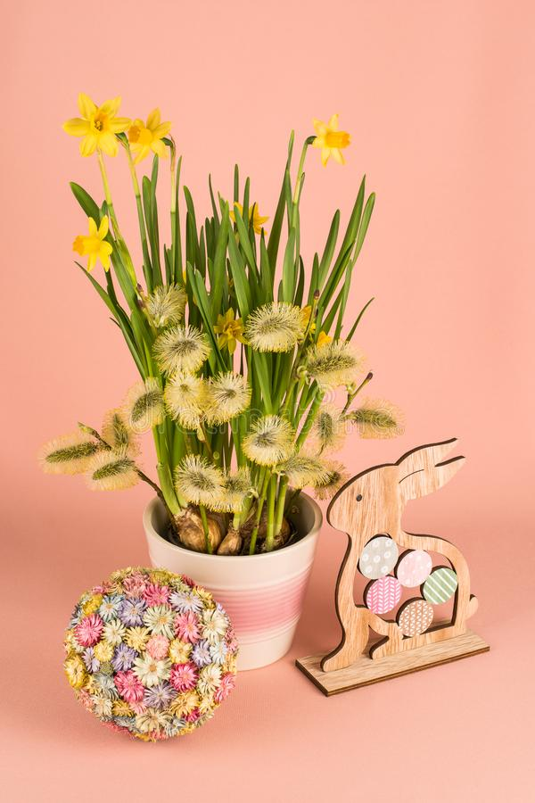 Spring composition with narcissus flowers, goat willow branches and Easter decor stock photo