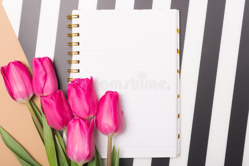 Spring concept. Fresh and bright background with spring flowers and blank paper. Free space. Copy space.Top view. Tulips royalty free stock photos