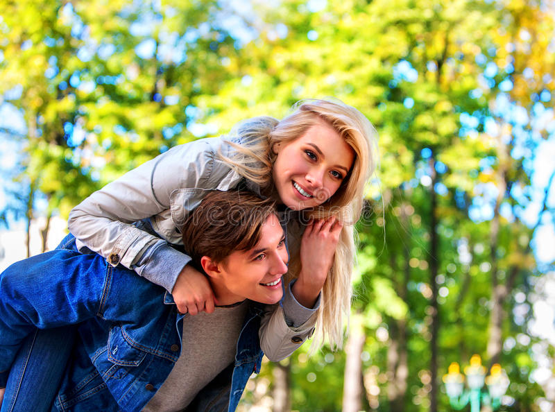 Spring couple walking park. Summer friends walk outdoor. Adventure trips for couples. Spring people walking park and kissing. Summer friends walk outdoor stock photography