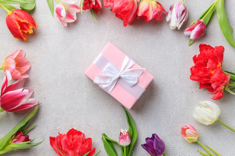 Spring creative holiday present with floral decor royalty free stock images
