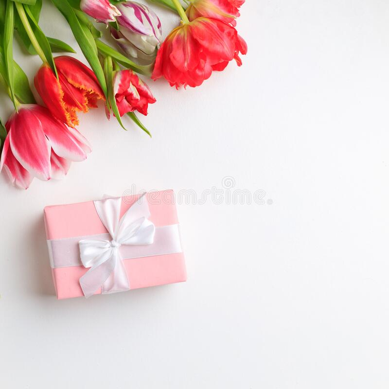 Spring creative holiday present with floral decor royalty free stock image