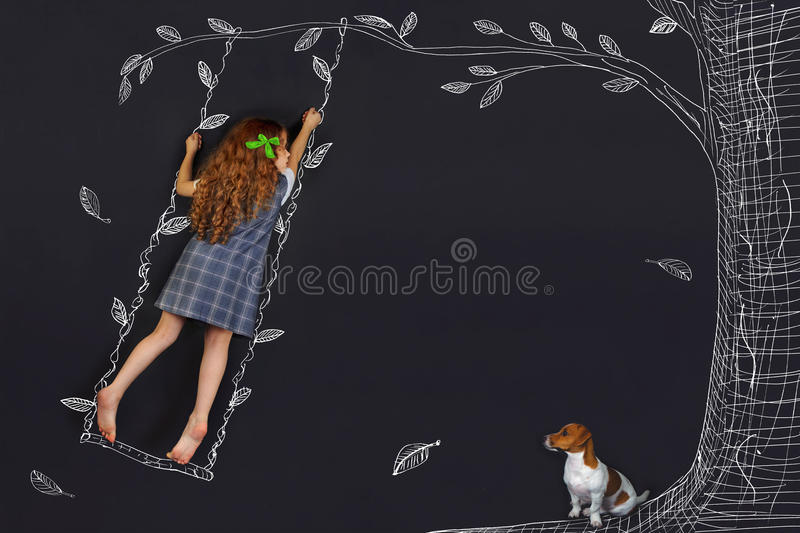 Spring curly girl on a swing. stock image