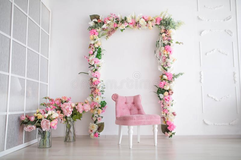 Spring decor with flowers in photo studio. stock image