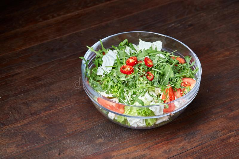 Dietary mixed salad in glass sultana on rustic wooden background, selective focus royalty free stock photos