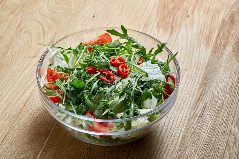 Dietary mixed salad in glass sultana on rustic wooden background, selective focus royalty free stock images