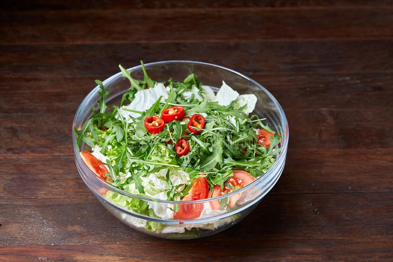 Dietary mixed salad in glass sultana on vintage wooden background, selective focus stock images