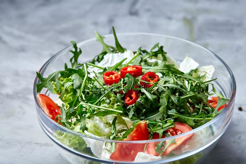 Dietary mixed salad in glass sultana on white textured background, selective focus, vertical stock photography