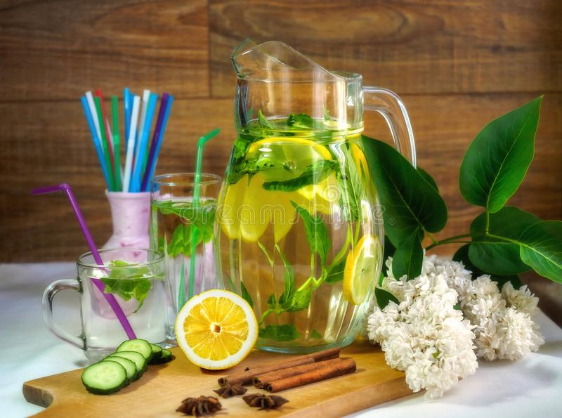 Spring drink for cheerfulness. Lilac, lemon, cinnamon, Anise Starry, beautiful and tasty royalty free stock photos