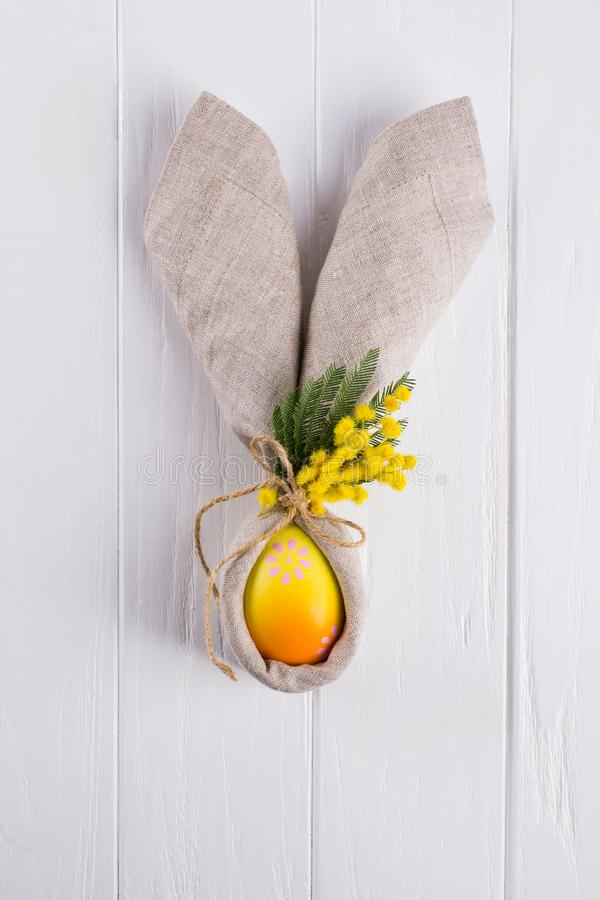 Spring Easter background for menu. Easter egg decoration, bunny ears linen napkin and kitchen cutlery on white stock photos
