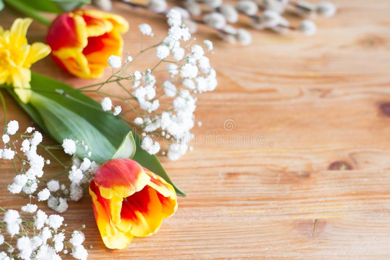 Spring easter flowers decoration on wooden background with free space. Abstract stock photos