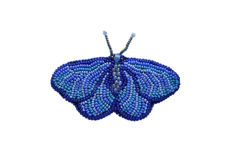 Spring fashion accessory brooch, isolated on white, can be used to print on clothes. Blue moth or butterfly with antennae, shiny. Beads, fashion item royalty free stock photos