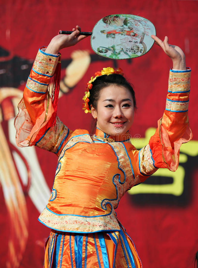 Spring Festival Temple Fair / Chinese female dance. BEIJING – FEBRUARY 13: A dancer performs during the Spring Festival Temple Fair at Ditan Park on royalty free stock photography