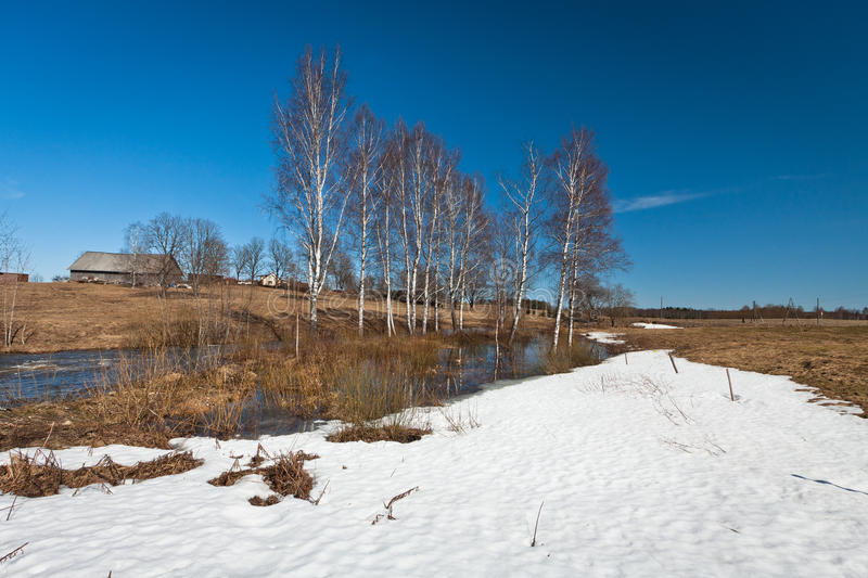 Spring flooding. Springtime flooding in rivers with ice stock images
