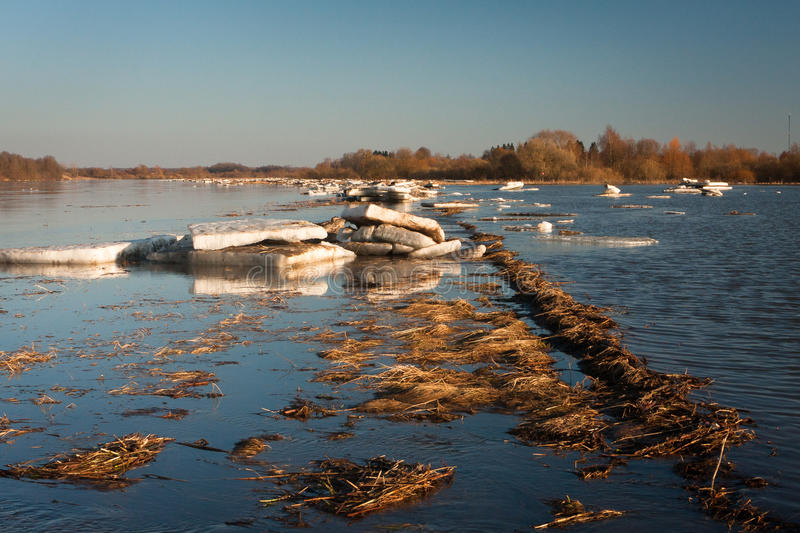 Spring flooding. Springtime flooding in rivers with ice stock image