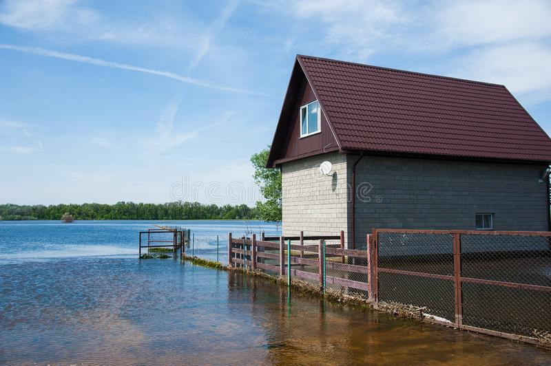Spring flooding in the village. Floods in the spring and a village house in the water stock images