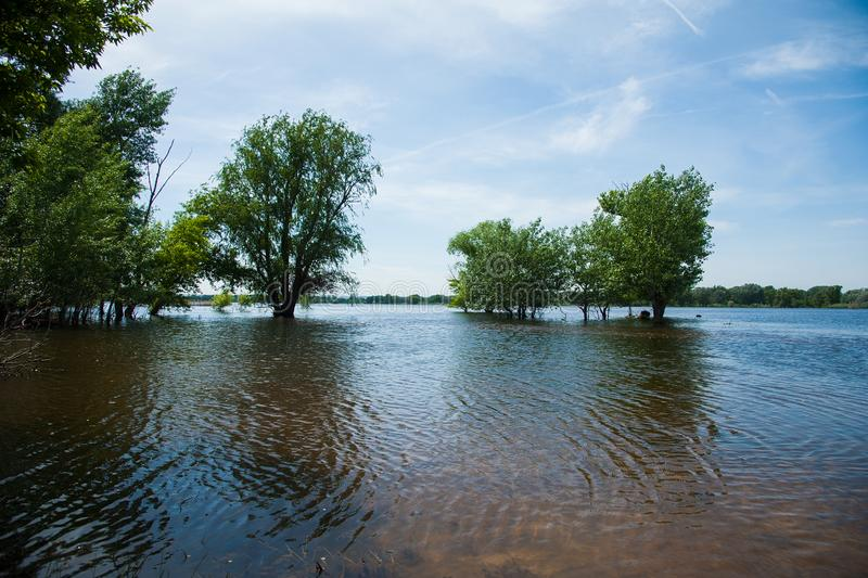 Spring flooding in the village. Floods in the spring and a village house in the water stock photo
