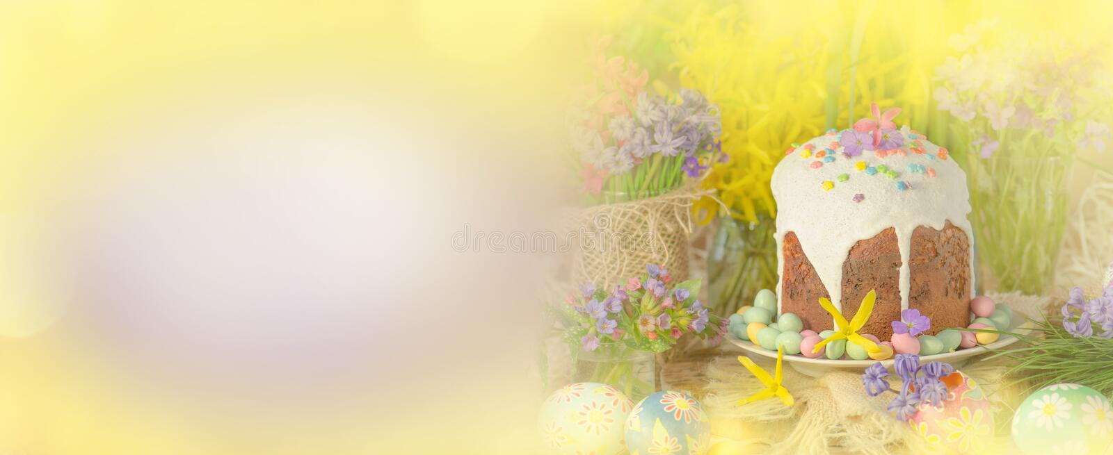 Spring flower banner background with Easter eggs. Easter holiday creative background. royalty free stock images