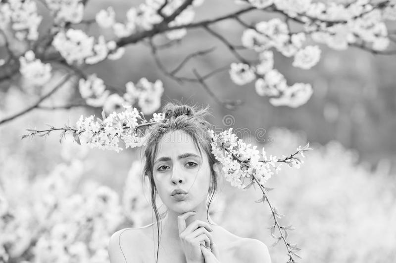 Spring flower in cherry garden with beautiful young girl. Or woman on natural background royalty free stock image