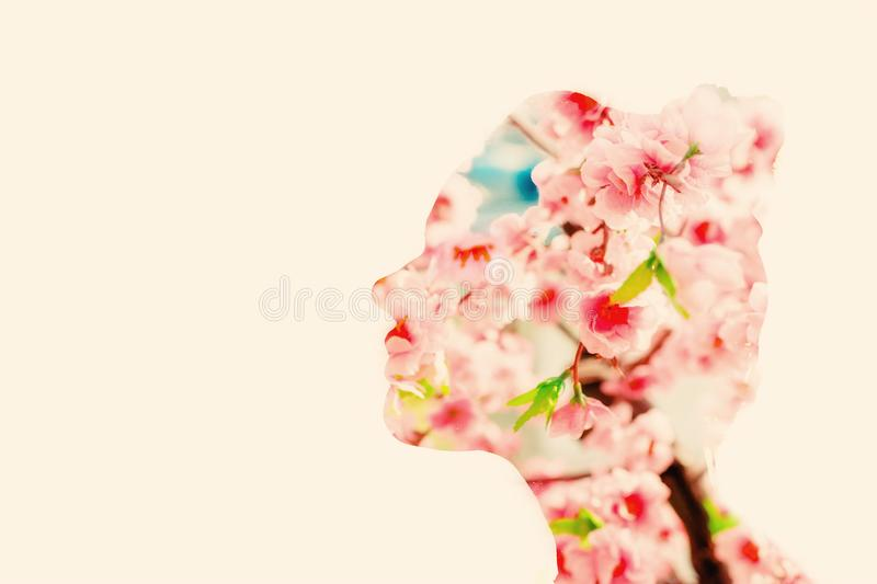 Spring flower woman, double exposure royalty free stock photography