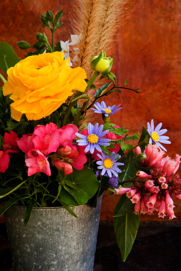Spring Flowers. Colorful arrangement of Spring flowers in a silver bucket stock photo