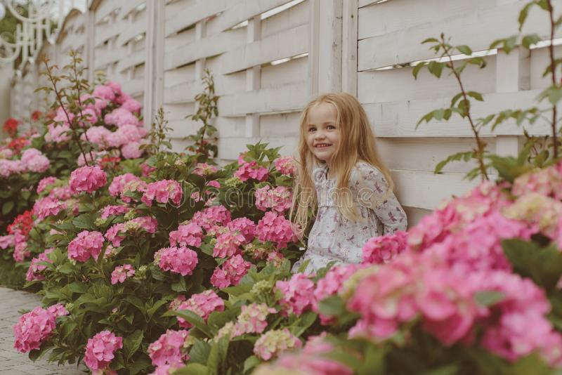 Spring flowers. Childhood. Childrens day. Small baby girl. New life concept. Spring holiday. Summer. Mothers or womens royalty free stock image