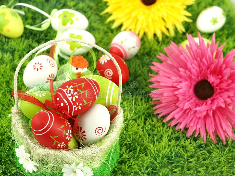 Spring flowers and colorful Easter eggs