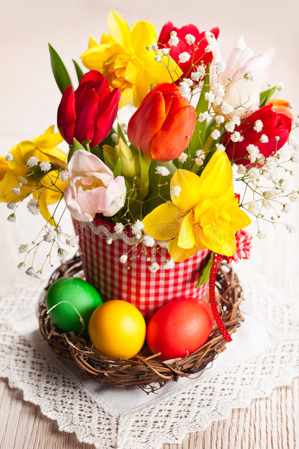 Spring flowers and Easter eggs stock photo