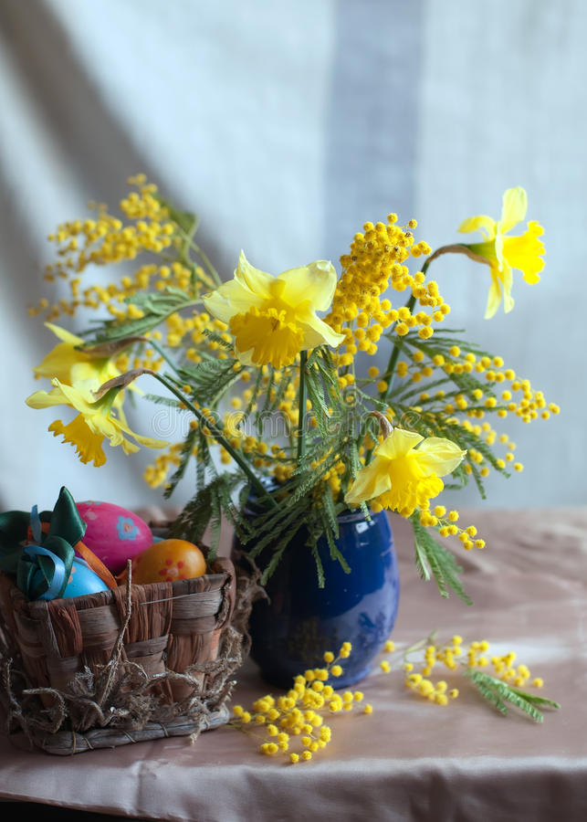 Spring flowers and hand made Easter eggs royalty free stock photography