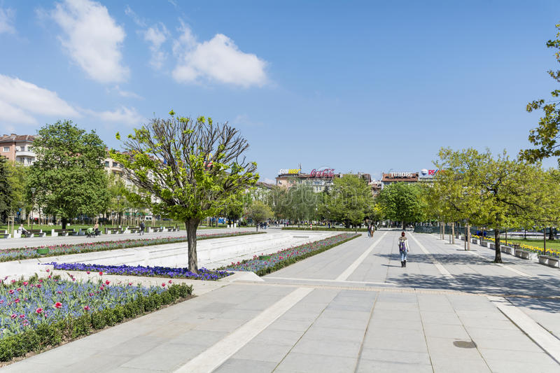 Spring garden with tulips in front of the National Palace of Culture, Sofia, Bulgaria. Spring blooming garden with tulips in front of the National Palace of royalty free stock photos