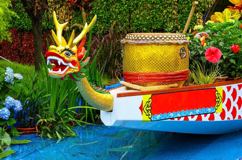 Ornamental chinese dragon boat and drum in garden. Spring garden view with traditional chinese dragon boat with drum on display royalty free stock photos