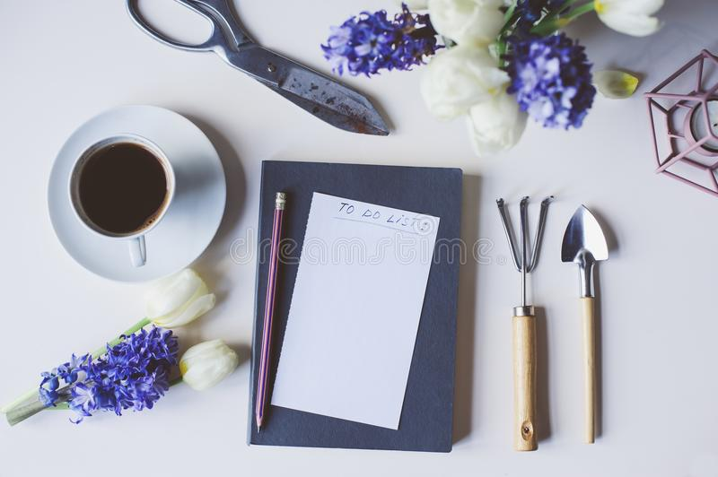 Spring gardener plan or to do list on table with empty space on spring gardener plan or to do list on table with empty space on white background flat lay top view seasonal composition with flowers garden tools mightylinksfo