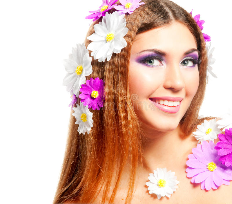 Spring girl. Closeup beautiful woman face with spring flowers stock image