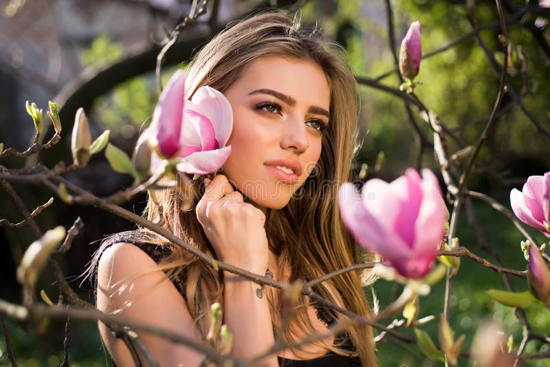 Spring girl in blooming garden. Magnolia. Summer girl and sensual moment. Beauty woman outdoors in blooming trees. Beauty modelin flowers stock photo