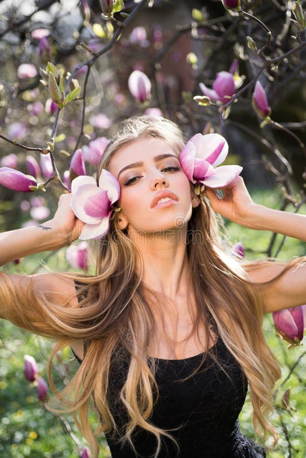 Spring girl in blooming garden. Summer girl and sensual moment. Beauty woman outdoors in blooming trees. Beauty woman in. Flowers. Magnolia stock images
