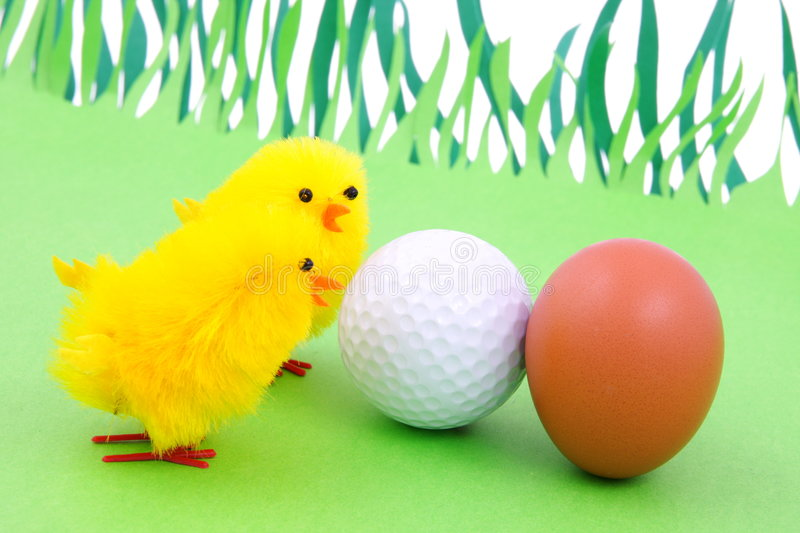Spring and golf. Style of life: leisure time, the joint family recreation. The association: egg - golf ball royalty free stock photo
